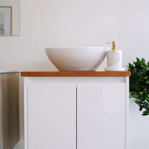 White wall hung vanity with bamboo top